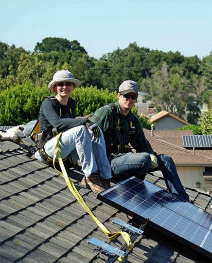 Volunteers helping homeowners experience the benefits of solar energy